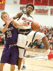 Bloomington South wing Chris Bomba gets tangled up with New Albany forward Julien Hunter on a rebound. 26 November 2016