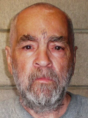 In this handout photo from the California Department of Corrections and Rehabilitation, Charles Manson, 74, poses for a photo on March 18, 2009, at Corcoran State Prison, Calif.