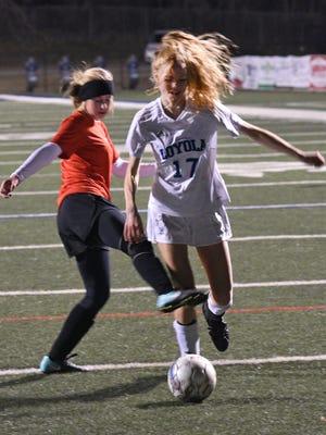 Loyola College Prep's Megan Maciulski scores a first half goal in a game against North Caddo.
