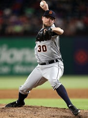 Detroit Tigers reliever Alex Wilson throws against the Texas Rangers in the sixth inning at Globe Life Park on May 7, 2018 in Arlington, Texas.