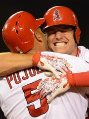 Trout hugs Pujols after Pujols hit a walk-off sacrifice