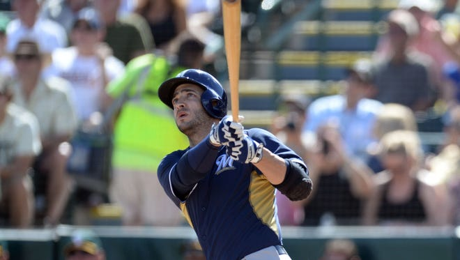 Ryan Braun hit an 0-1 pitch off Tommy Milone high over the wall near the left field corner, 345 feet away.