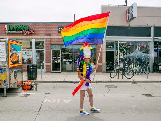 "The official ""Pope of Pride"" Gordon Matson, 58, of Oak Park walks down Nine Mile Road at the Ferndale Pride Festival in Ferndale, MI on June 2, 2018."