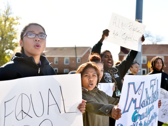 York County School of Technology students, including senior Desiree Turner, 17, far left, and senior Sandy Moreno-Bacho, 18, center, stand outside the school in protest of alleged racially motivated harassment at the school the day after the U.S. presidential election Friday, Nov. 11, 2016, on the corner of South Queen Street and Pauline Drive. A video circulated Wednesday showing students carrying a Donald Trump campaign sign inside the school, and allegations of other incidents, such as students of color being spat on and called racial slurs, later surfaced.