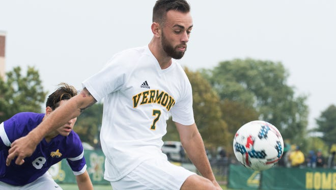 Vermont's Justin Freitas (7) plays the ball during the men's soccer game between the Albany Great Danes and the Vermont Catamounts at Virtue Field on Saturday afternoon October 7, 2017 in Burlington.