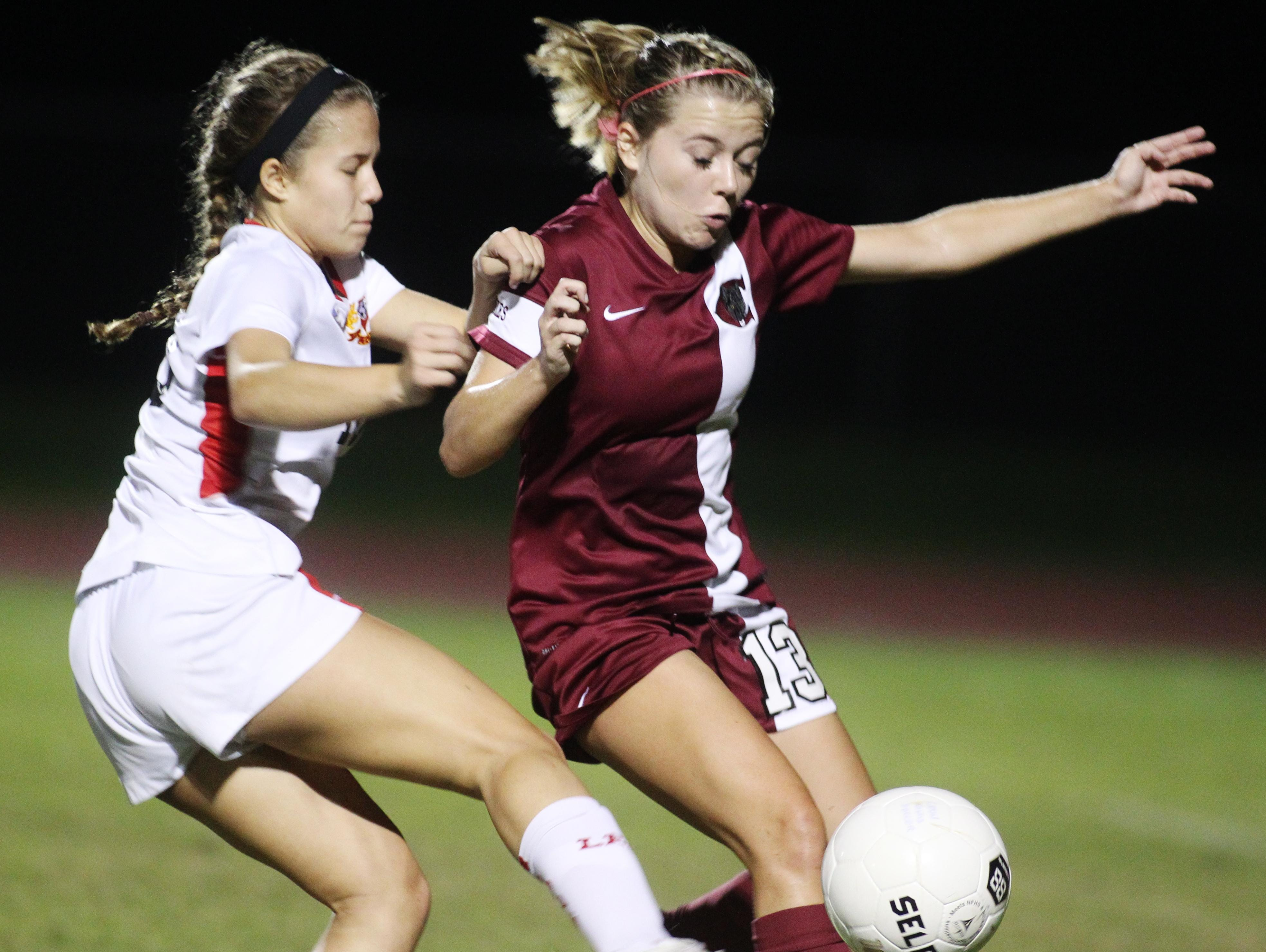 Chiles' Kinsley Emerson battles Leon's Lilli Hanks for the ball in a game between Leon and Chiles.
