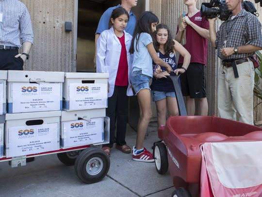 Yael Cohen, 11; Iliana Perkel, 11; and Sara Iyer, 11;