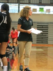 Surveying the action Thursday night is new Plymouth varsity volleyball coach Sheila Weber.
