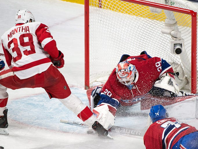 Montreal Canadiens goaltender Mike Condon makes a save