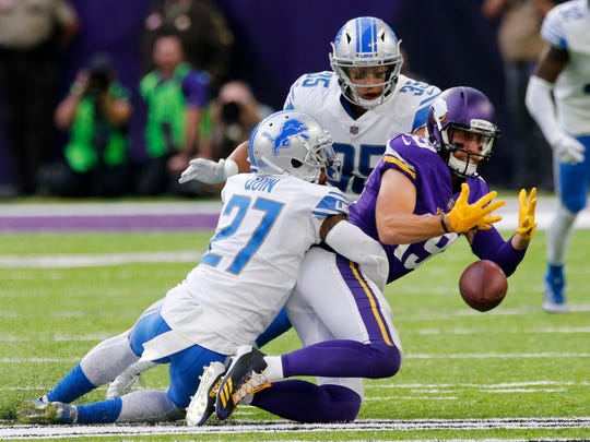 Vikings receiver Adam Thielen fumbles as he is tackled by Lions safeties Glover Quin and Miles Killebrew late in the fourth quarter. The Lions recovered to seal their 14-7 win Sunday, Oct. 1, 2017 in Minneapolis.