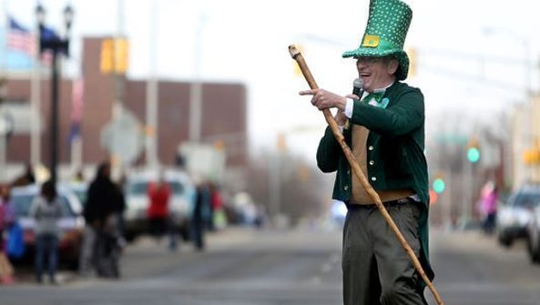 A participant in a past St. Patrick's Day Parade in