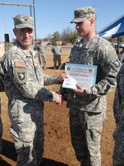 Justin Bannister, right, served for four years as a U.S. Army medic.