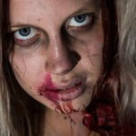 Lina Deruiter dresses like a  zombie during the Downtown Phoenix Zombie Walk Saturday.