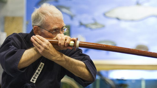 Bob Wnukowski, of Fort Myers, readies for an attack while practicing during an Art of Samurai class Monday (6/1/15) at Rotary Park in Cape Coral. The class is held Mondays at 7pm by insctructor Hilmar Fuchs who has been practicing the art for 50 years.