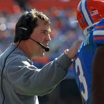 Florida Gators head coach Will Muschamp talks with linebacker Antonio Morrison (3) against the South Carolina Gamecocks during the first quarter at Ben Hill Griffin Stadium.