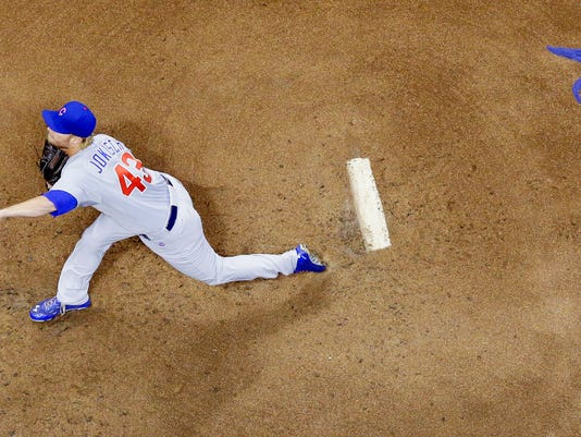Chicago Cubs starting pitcher Eric Jokisch throws during the first inning of a baseball game against the Milwaukee Brewers, Friday, Sept. 26, 2014, in Milwaukee. (AP Photo/Morry Gash)