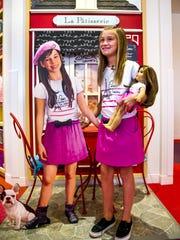 "Alanna Davis, 9, of Gilbert, holds onto her doll, ""Grace"""