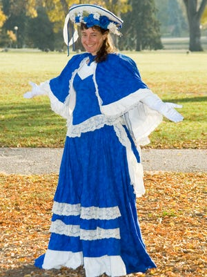 Amy Marschak, a street poet who is suing Palm Springs, poses in the Victoria dress in which she often performs.