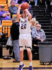 Sam King lets a 3-pointer go during Wylie's 76-31 win against Snyder on Friday, Jan. 12, 2018 at Bulldog Gym. King finished with 12 points for the Bulldogs.
