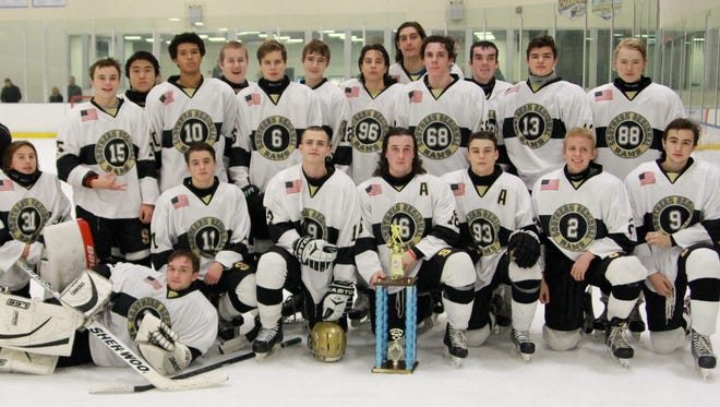 Southern Regional hockey celebrates its 4-3 Winding River Holiday Tournament win over Central Regional on Tuesday.