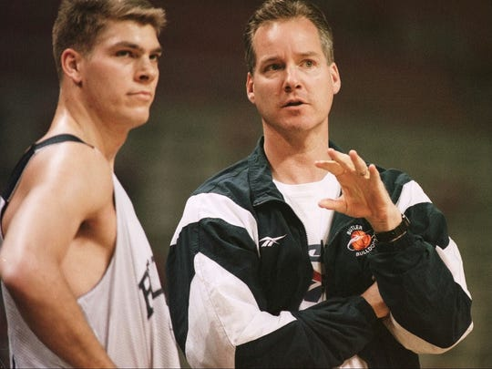 3/12/97: Butler Bulldog's Coach Barry Collier confers with player Jon Neuhouser during the practice hour Wednesday afternooon, March 12, 1997, in Auburn Hills, Michigan. (Patrick Schneider/Staff Photo)