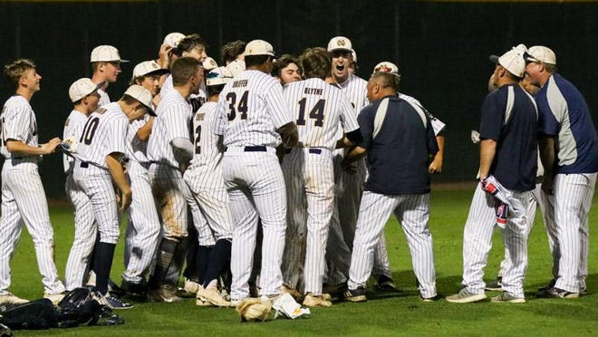 The Notre Dame High School baseball team celebrates Wednesday's 7-5 victory over North Cedar in a Class 1A substate championship game at Solon.