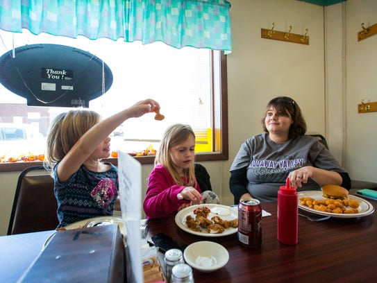 Gina Ward, 30, and her daughters Paiton, center, and