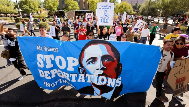 Upset with President Barack Obama's immigration policy, about 250 people march to the U.S. Immigration and Customs Enforcement office in 2013 with a goal of stopping future deportations.