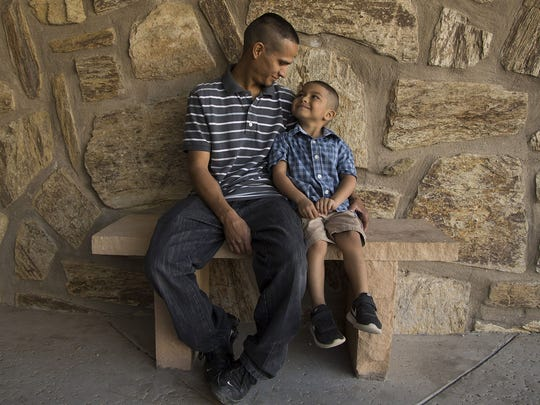 Jesus Berrones sits with his 5-year-old son Jayden