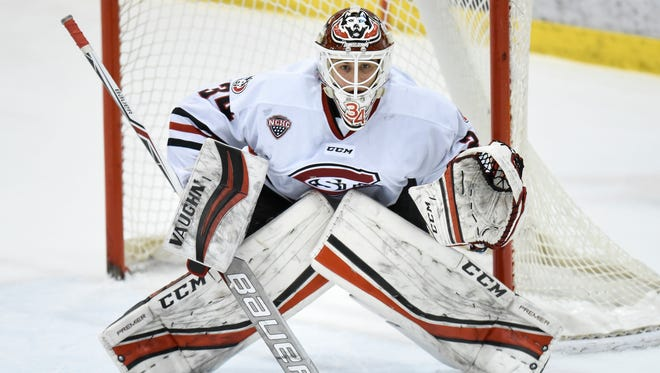 St. Cloud State goaltender David Hrenak concentrates on the puck during the first period of the Sunday, March 11, game at the Herb Brooks National Hockey Center in St. Cloud.