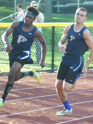 Saddle Brook's Sean Roberts (right) and Andrew Wellington sprinting by the competition in the 200-meter race at NJIC Meadowlands Division meet.