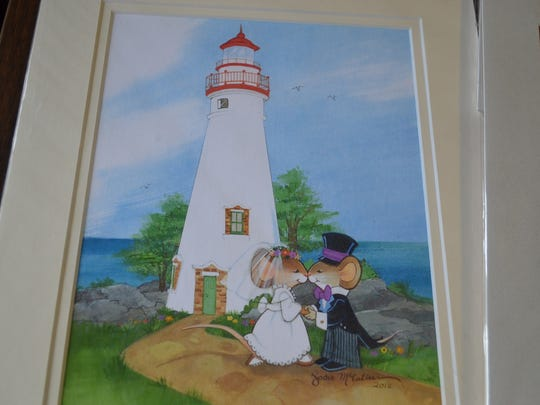 This print of the Marblehead Lighthouse is one of many whimsical McCallum pieces that feature lake life.