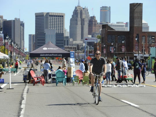 People bike and walk westbound on Michigan Avenue from Rosa Parks Boulevard as they enjoy the weather and the atmosphere of Open Streets Detroit on Sunday. The next one is next Sunday, also from noon to 5 p.m. on Michigan Avenue and Vernor Highway.