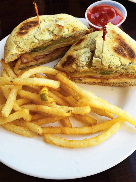 Cuban Pollo (9.95) comes with chicken, ham, spicy pickles, Swiss cheese, chipotle mayonnaise and honey mustard, with a side of fries.