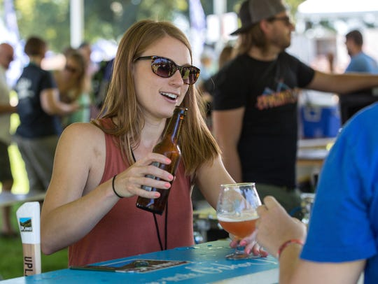 A representative pours a beer sample at the 2017 Milwaukee