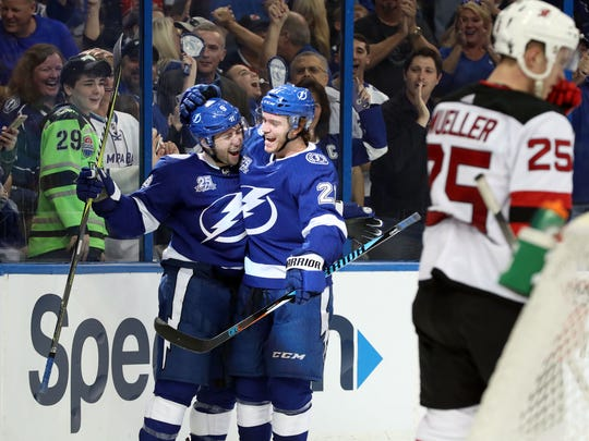 Tampa Bay Lightning center Tyler Johnson (9) is congratulated