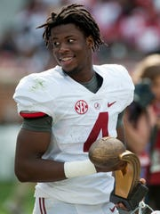 Alabama wide receiver Jerry Jeudy (4) is given the MVP award following the A-Day scrimmage game at Bryant Denny Stadium in Tuscaloosa, Ala., on Saturday April 22, 2017. (Mickey Welsh / Montgomery Advertiser)