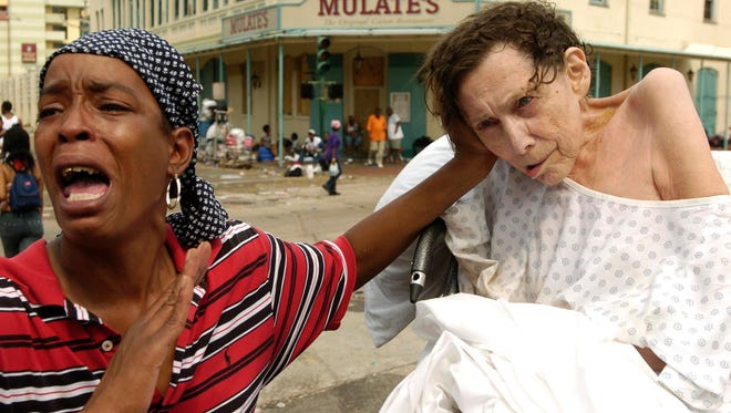 Sarah Johnson yells for help outside the convention center in New Orleans in the aftermath of Hurricane Katrina on Sept. 1, 2005.