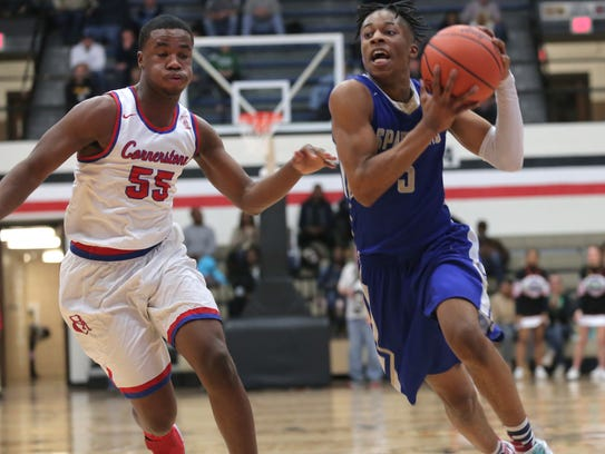 St. Peter's Elijah Cobb moves the ball down the court