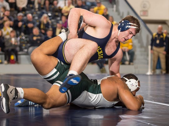 Michigan's Adam Coon ties up a Michigan State wrestler