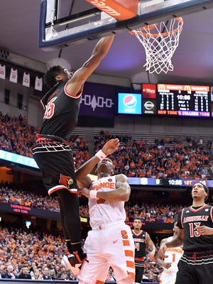 Louisville Cardinals guard Donovan Mitchell (45) makes a dunk as Syracuse Orange guard Andrew White III (3) trails and teammate forward Ray Spalding (13) looks on during the first half of a game at the Carrier Dome.