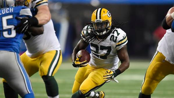 Green Bay Packers running back Eddie Lacy (27) looks for room to run against the Detroit Lions during Thursday night's game at Ford Field in Detroit, Mich.