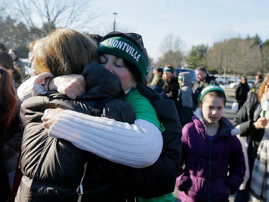 Dr. Cathy Lundquist of Montville hugs Nan Rothberg