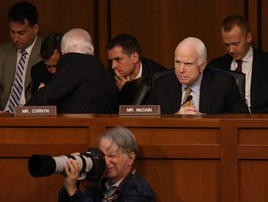 U.S. Sen. John McCain, R-Ariz., listens at the Senate