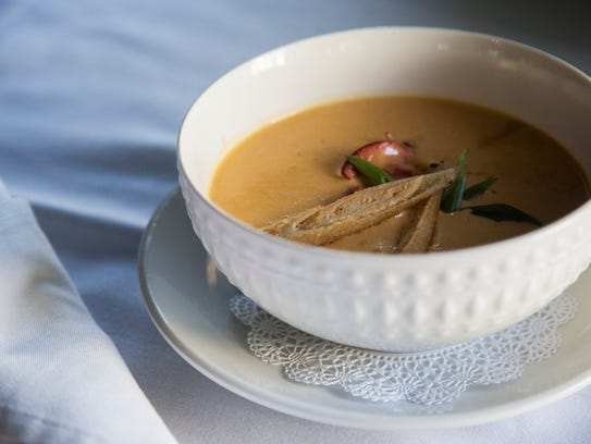 The Lobster Bisque with sherry poached Maine lobster
