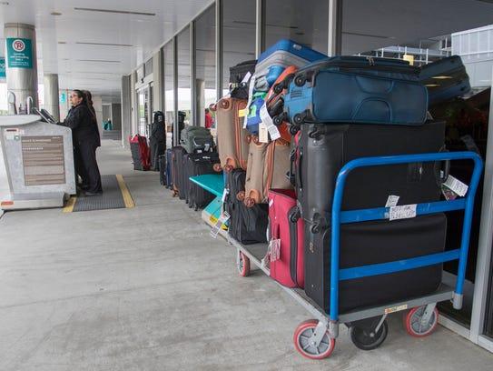 Baggage waits to be processed at Pensacola International