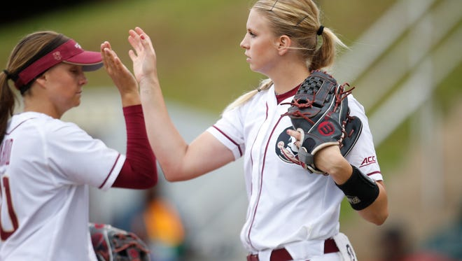 FSU's Jessica Burroughs, right, high fives Sabrina Stutsman during their NCAA Regional game against FAMU at JoAnne Graf Field on Friday May 20, 2016.