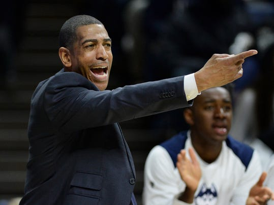 Connecticut head coach Kevin Ollie works the sidelines in the second half of an NCAA college basketball game against Cincinnati, Saturday, Feb. 3, 2018, in Storrs, Conn. Cincinnati won, 65-57. (AP Photo/Stephen Dunn)