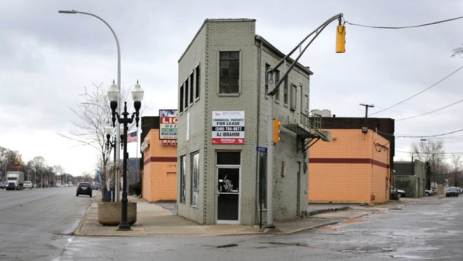 River Rouge city councilman Daniel Cooney and a group of people are leading an effort to market vacant properties in River Rouge such as this building on West Jefferson Avenue to the displaced tenants of the Russell Industrial Center as well as artists and small businesses on Wednesday, March 1, 2017.