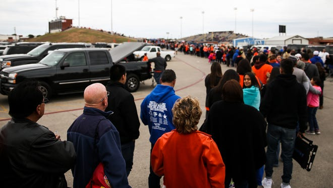 Fans wait in a long line to enter the stadium for the Central vs Allen Class 6A Division I regional semifinal Friday, Nov. 25, at San Angelo Stadium.